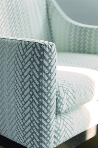 Upholstered chair in Lazarus Laneway FR fabric in Aqua with herringbone pattern