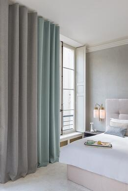 FR dimout curtain fabric aten in a soft mood hotel room colour