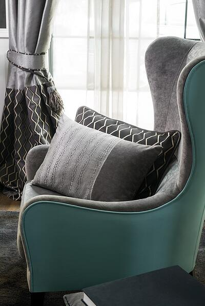 FR dimout curtain fabric in front of a statement green armchair_aten collection