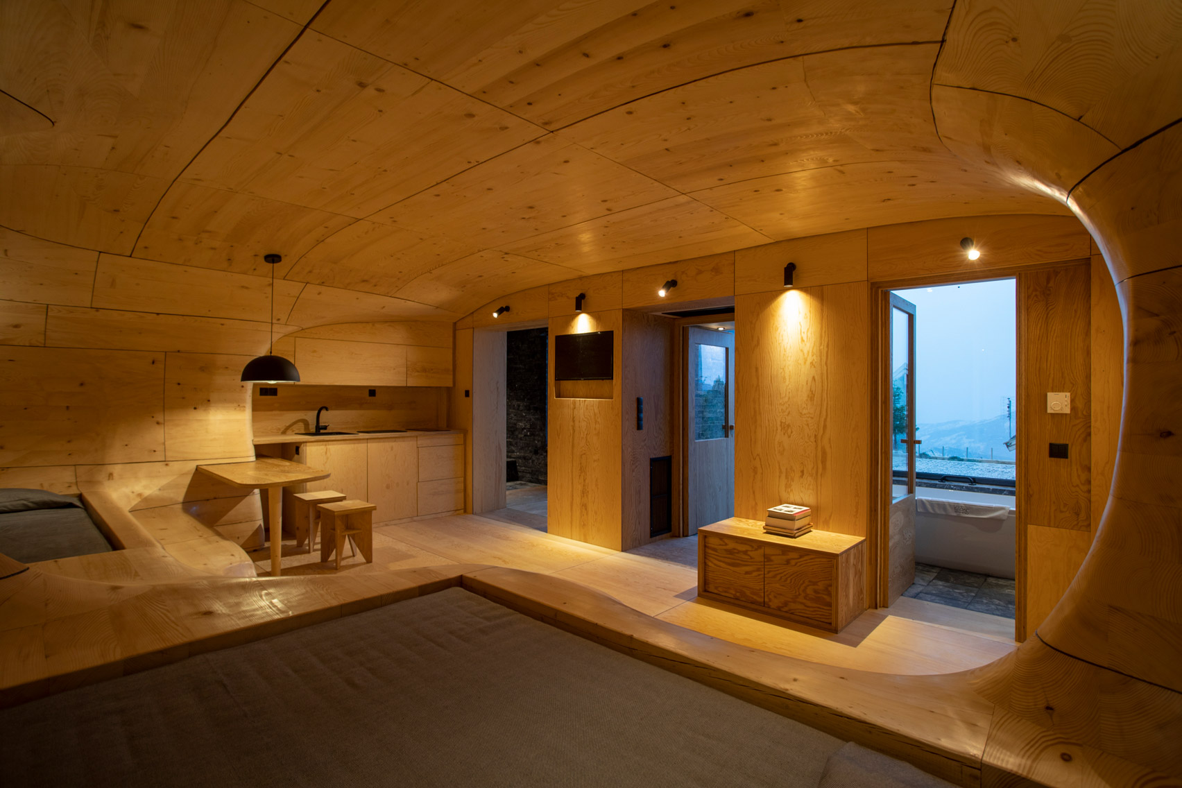 Wooden Cave hotel suite in Greece is made from over 1,000 pieces of hand-cut spruce