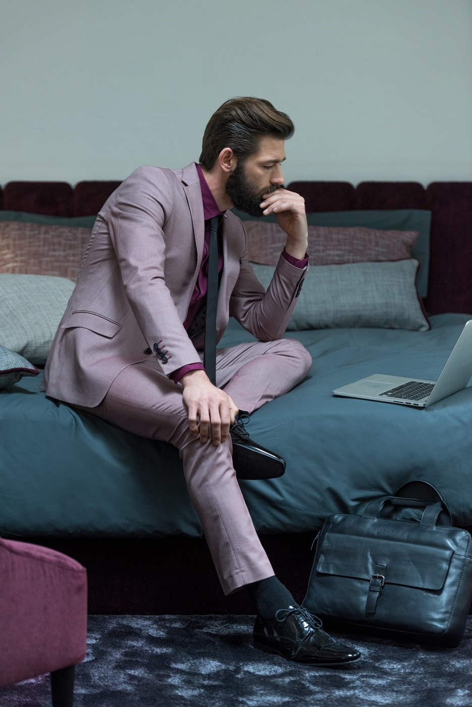 business traveler in a chic hotel room_lithology collection fr fabrics