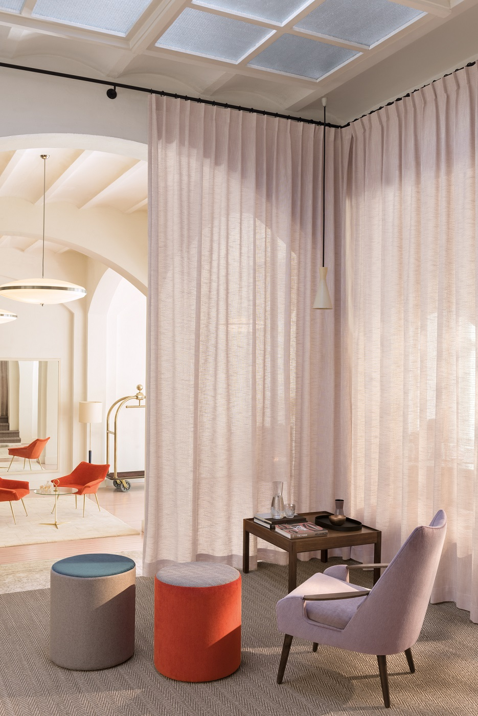 fr sheer curtains and an elegant armchair with poufs_lucence collection