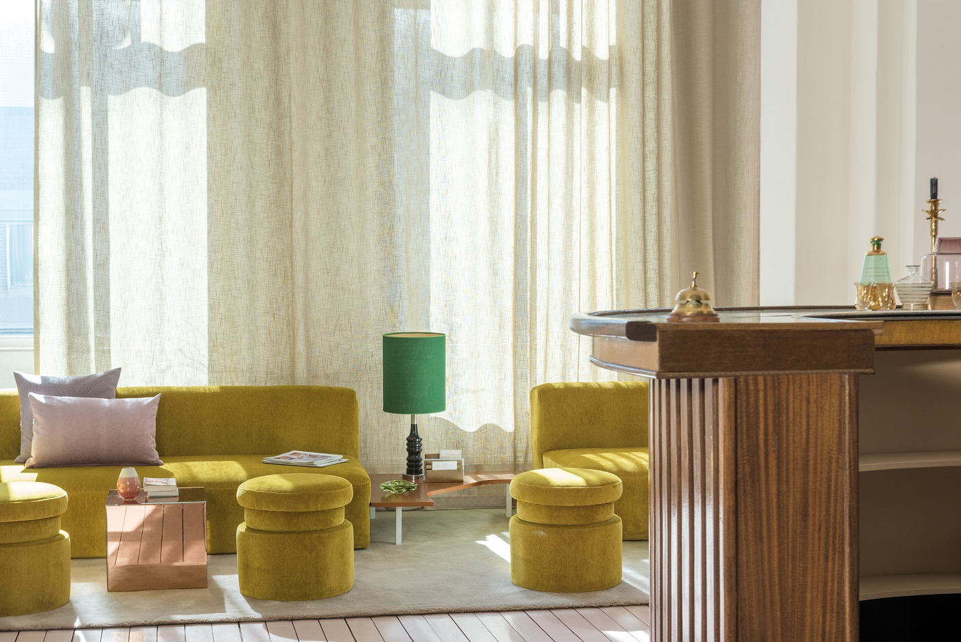 sunny yellow lobby with flowy sheer curtains_lithology collection fr fabrics