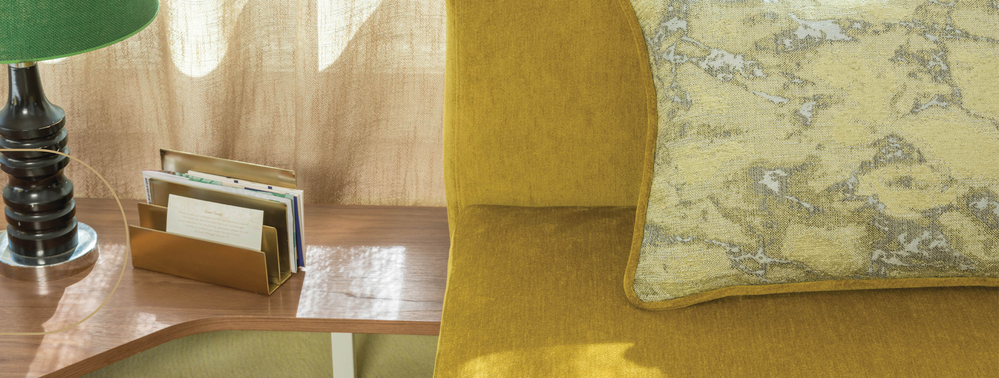 A chic armchair with canary yellow FR upholstery